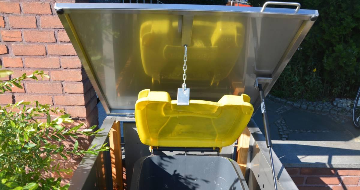 Klappdach mit Gasdruckdämpfer einer Mülltonnenbox - RESORTI